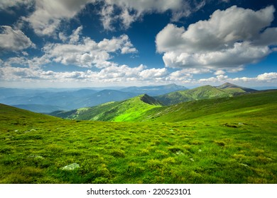 summer landscape. Green mountain  on the blue sky background