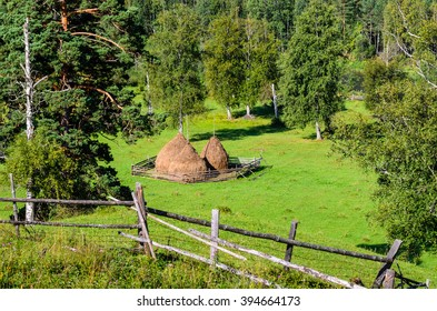 Summer landscape with haystacks in the mountains of the Southern Urals.