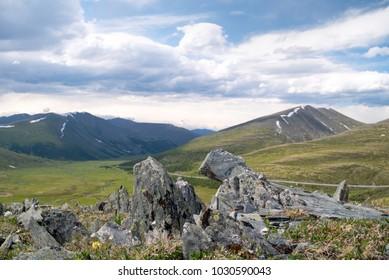 Summer landscape in Khakassian high mountains and cloudy sky