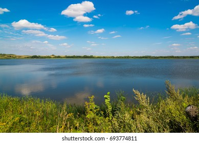 Summer landscape with lake in central Russia in August. Front focus