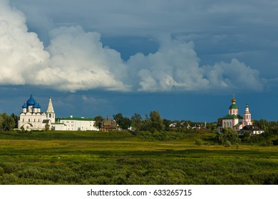 Summer landscape with main attractions of Suzdal: Nativity Cathedral and Bishop's chambers of Suzdal Kremlin and Church of St. Elijah in Ilyinsky meadow.