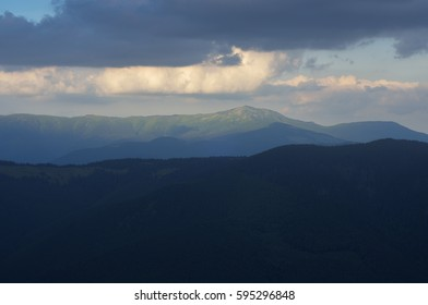 Summer landscape with a mountain peak. Cloudy sky. Carpathians, Ukraine, Europe