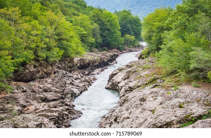 Summer landscape with mountain river. Belaya River in Republic of Adygea, Russia.