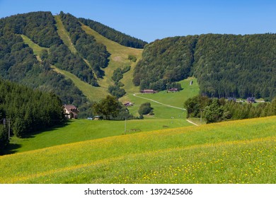 Summer landscape in the mountains. View from above  the tops of the mountains, covered with forest. Mountain village. Slovakia,  Trencin region, near Klacno. Tourist destination, tourism, hiking.