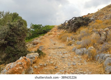 Summer landscape with old mountain road in Crete, Greece.