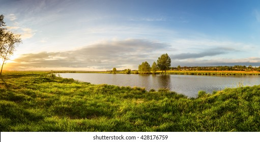 summer landscape on the banks of the green river at sunset, Russia, Ural