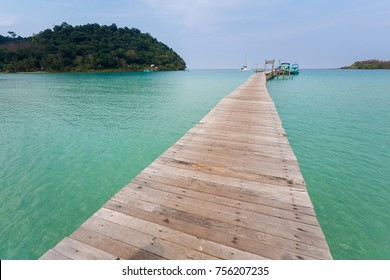 Summer landscape on tropical koh Kood island in Thailand. Landscape with long wooden pier taken on Bang Bao beach.