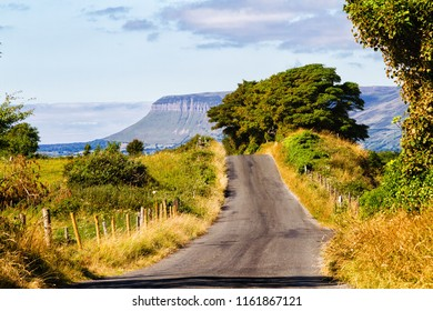 Summer landscape of pastures, hills and meadows in popular and picturesque Sligo area. View of famous Ben Bulben mountain.