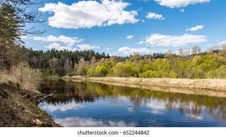 summer landscape of river with clouds and reflections