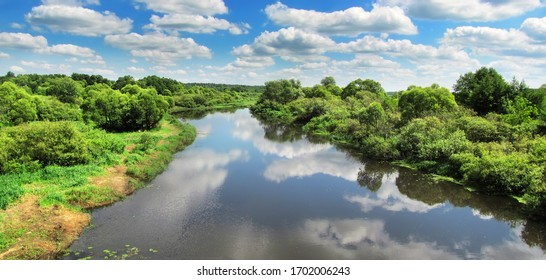 Summer landscape with river and sky with white clouds