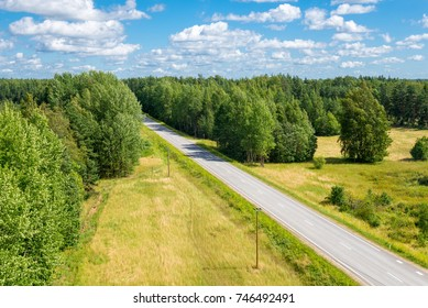 summer landscape with road among the forest (top view)