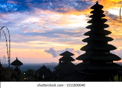 Summer landscape with roofs black silhouette at sunset on Bali, Indonesia. Pura Besakih temple, mother of Balinese Hindu temple