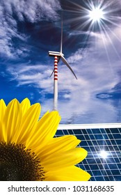 summer landscape with sunflower and solar panel in the foreground and wind turbines in the background