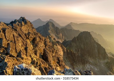 Summer landscape. Sunrise in mountains. View from Baranie Rohy peak in High Tatra Mountains, Slovakia.