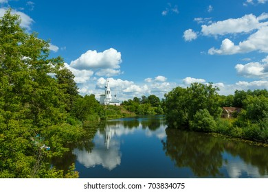 Summer landscape in Suzdal with river, temple on the hill and beautiful clouds in the sky.