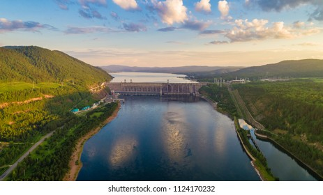 Summer landscape a view of a dam of hydroelectric power station and a reservoir, shooting from air