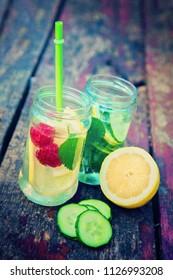 Summer lemonade cocktails with fruit and vegetables