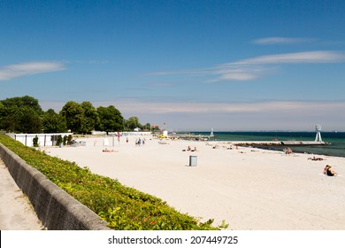 Summer life on a sunny summer day at Bellevue beach in Hellerup, a suburb of Copenhagen, Denmark.