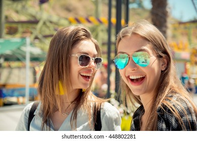 summer lifestyle portrait of two best friends laughing and talking outdoor on the street in city center