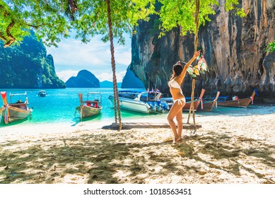 Summer lifestyle traveler asian woman in bikini enjoying relaxing on natural sea beach, Lao lading island, Krabi, Travel Thailand, Beautiful destination landscape sea beach Asia, Outdoor vacation trip