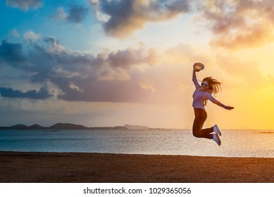 Summer lifestyle traveler woman joy reraxing and jumping on lakeside at sunset time, Beautiful destination natural in Asia, Summer holiday outdoor vacation travel trip