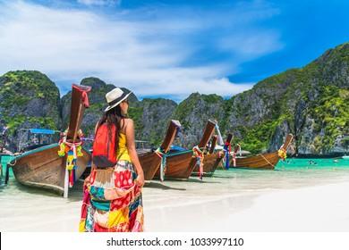 Summer lifestyle traveler woman joy relaxing on natural sea beach, Maya beach, Phi Phi island, Krabi, Travel in Thailand, Beautiful destination landscape Asia, Holiday summer outdoor vacation trip