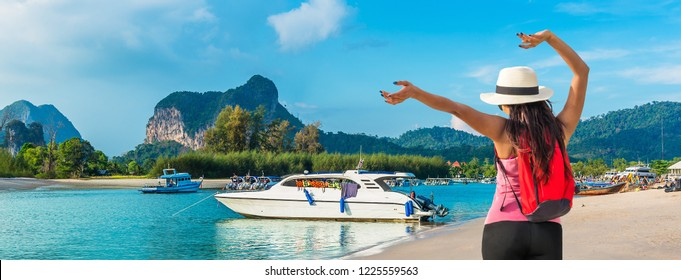 Summer lifestyle young traveler woman joy fun panorama Noppharat Thara beach scenic landscape with tourist boat, Happy water travel Phuket Thailand holiday vacation trip Tourism destination place Asia