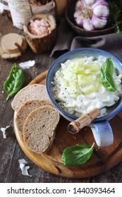 Summer light salad: Greek yoghurt, garlic, greeb herbs and cucumber, rustic style