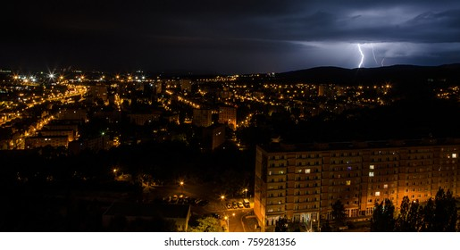 Summer lightning and a storm over the city from hot weather.