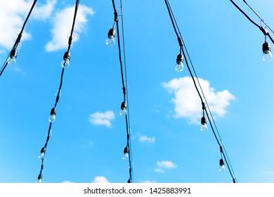 Summer lights on blue sky background