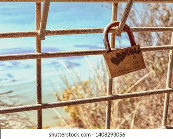 Summer love locket on fence