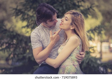 Summer love, young cute couple hugging and enjoying young love