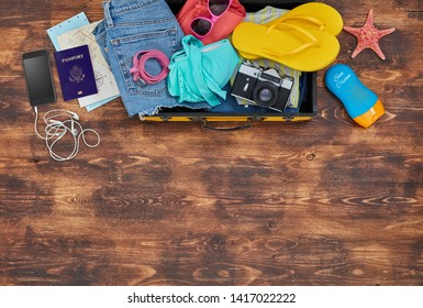 Summer luggage with clothing and personal accessories