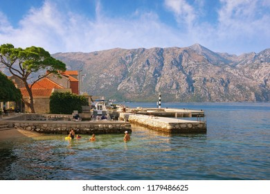 Summer Mediterranean landscape. Montenegro,  Adriatic Sea, Bay of Kotor. View of  Prcanj town