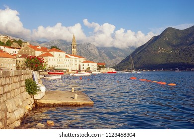 Summer Mediterranean landscape. Montenegro, Bay of Kotor. View of the ancient town of Perast with the bell tower of the church of St. Nicholas