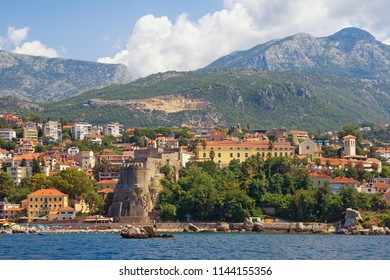 Summer Mediterranean landscape. Montenegro. View of coastal town of Herceg Novi located at the foot of Mount Orjen