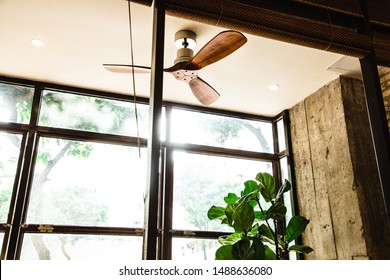 Summer minimalist style interior with old ceiling fan ceiling and clear glass windows