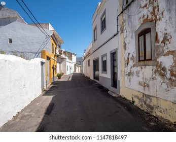 Summer mood of the alley in the old town of Estoi, Algarve, Portugal
