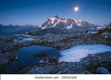 Summer moon rising behind Mount Shuksan, Washington state