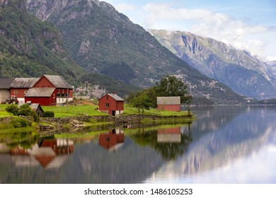 Summer morning in Norway, a village near the small town of Odda, on the river Opo. In the background you can see the glaciers of Folgefonna National Park.