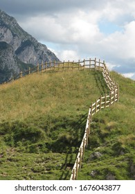 summer mountain alpine pasture with fence