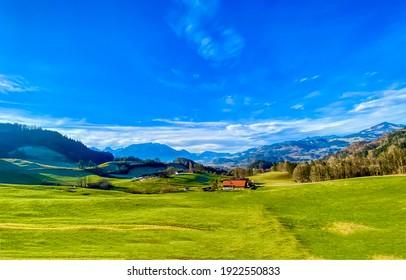 Summer mountain green field blue sky landscape. Mountain green valley meadow landscape. Green meadow in mountain valley. Summer green meadow in mountain valley - Shutterstock ID 1922550833