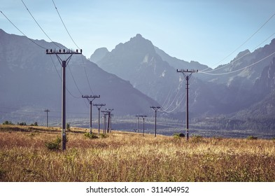 Summer mountain landscape. Beautiful view on the electric poles and High Tatra Mountains, Slovakia.