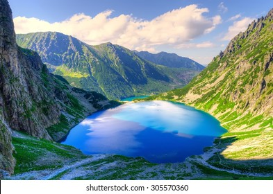 Summer mountain landscape. Czarny Staw and Morskie Oko in Polish Tatra Mountains.