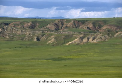 Summer Mountain Landscape with green hills and stone formations