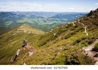Summer mountain landscape with man standing on the rocky hill