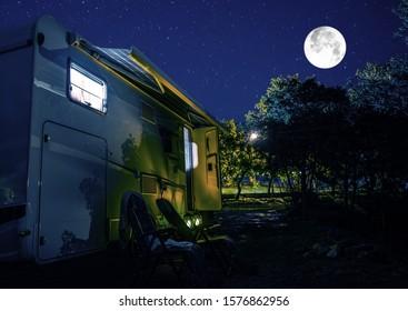 Summer Night RV Camping. Recreational Vehicle Class C Motorhome Under Starry Sky. Campground RV Park Pitch. Modern Camper Van.