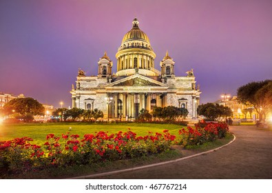 Summer night at St. Isaac's Cathedral and red roses in front of him