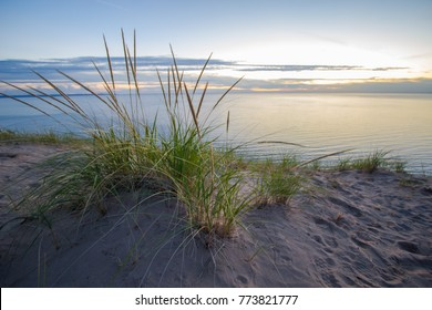 Summer Nights. Dune grass on the edge of a massive sand dune at twilight on the shores of Lake Michigan. Sleeping Bear Dunes National Lakeshore, Michigan, USA.