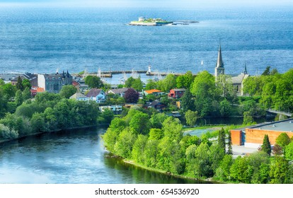 Summer in the norwegian city Trondheim. Aerial view of the Trondheim fjord, the island Munkenholmen, The river Nidelva and Ila church.